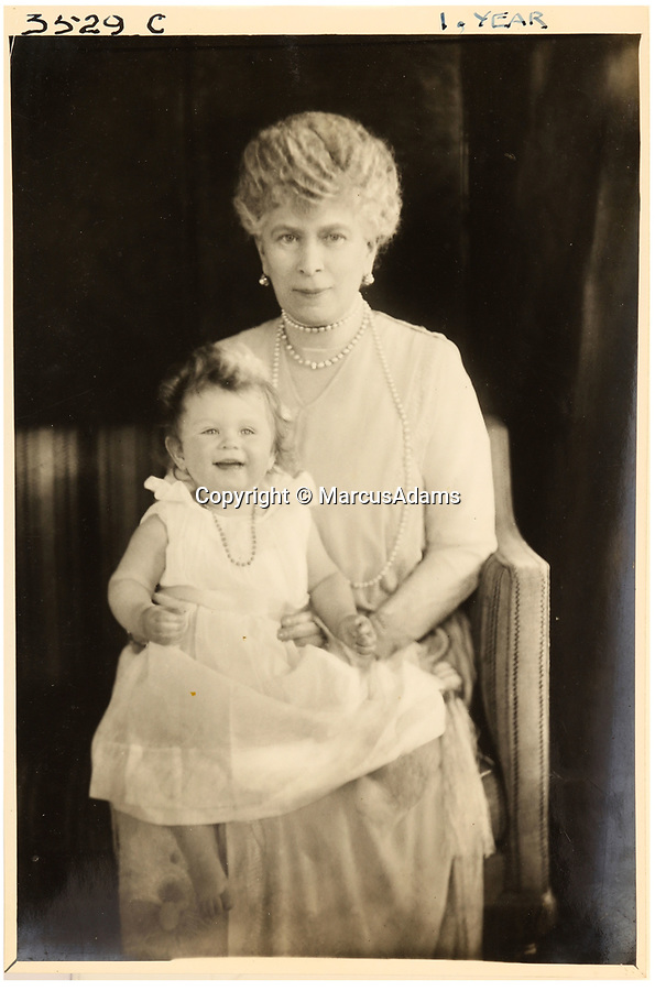 BNPS.co.uk (01202 558833)<br /> Pic: MarcusAdams/ChiswickAuctions/BNPS<br /> <br /> Princess Elizabeth(1) with her grandmother Queen Mary in 1927.<br /> <br /> Charming childhood photos of Princess Elizabeth and Princess Margaret have come to light, including a previously unseen image of the future Queen in a kilt.<br /> <br /> The portraits, taken by acclaimed British society photographer Marcus Adams, capture the future Queen from being a baby to her adolescence.<br /> <br /> The Queen Mother would often take her daughters to his central London studio where he would set up toys and props to keep them entertained