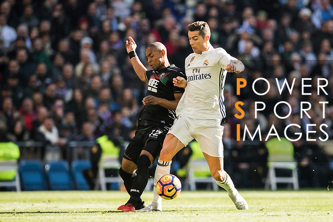 Cristiano Ronaldo (r) of Real Madrid fights for the ball with Gabriel Silva of Granada CF during their La Liga match between Real Madrid and Granada CF at the Santiago Bernabeu Stadium on 07 January 2017 in Madrid, Spain. Photo by Diego Gonzalez Souto / Power Sport Images