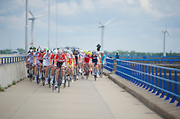 peloton over the Haringvlietsluis, with Lotto-Belisol leading the way<br /> <br /> 3rd World Ports Classic 2014<br /> stage 1: Rotterdam - Antwerpen 195km