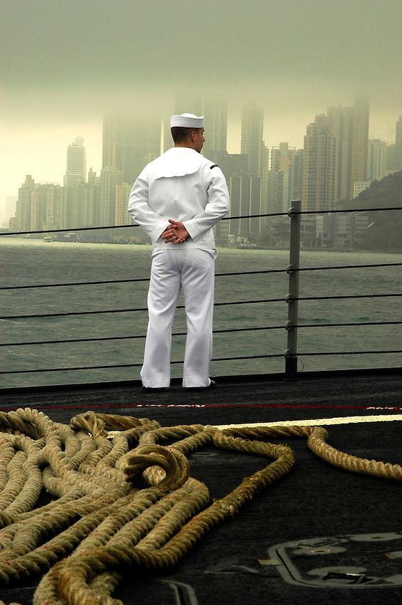 Pacific Ocean (April 10, 2006)- A Sailor aboard the Guided Missile Destroyer USS Shoup mans the rails as Shoup departs Hong Kong Harbor. Shoup is currently underway in the Western Pacific area of operations. U.S. Navy photo by Photographer's Mate Airman James R. Evans (RELEASED)