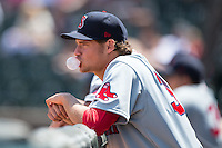 Trey Ball (37) of the Salem Red Sox blows a bubble while watching the game against the Winston-Salem Dash at BB&T Ballpark on May 31, 2015 in Winston-Salem, North Carolina.  The Red Sox defeated the Dash 6-5.  (Brian Westerholt/Four Seam Images)