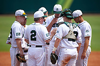 Dartmouth Big Green head coach Bob Whalen (2) talks with starting pitcher Michael Danielak (34) as (clockwise) Steffen Torgersen (29), Justin Fowler (25), Dustin Shirley (6), Joe Purritano (3), and Adam Gauthier (18) listen in during a game against the South Florida Bulls on March 27, 2016 at USF Baseball Stadium in Tampa, Florida.  South Florida defeated Dartmouth 4-0.  (Mike Janes/Four Seam Images)