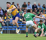 Keelan Sexton of Clare in action against Daniel Daly of Limerick during their Munster championship quarter-final game in Cusack park. Photograph by John Kelly.