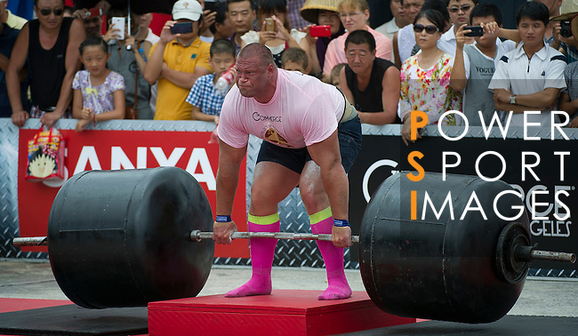 HAINAN ISLAND, CHINA - AUGUST 24:  Terry Hollands of United Kingdom competes at the Deadlift for Max event during the World's Strongest Man competition at Yalong Bay Cultural Square on August 24, 2013 in Hainan Island, China.  Photo by Victor Fraile