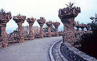 Promenade of stone columns at Parc Guell designed by Antoni Gaudi. Barcelona, Spain. Gaudi used stones from the park.