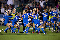 Kodi Lavrusky, Abby Dahlkemper, Chelsea Stewart. UCLA advanced on penalty kicks after defeating Virginia, 1-1, in regulation time at the NCAA Women's College Cup semifinals at WakeMed Soccer Park in Cary, NC.