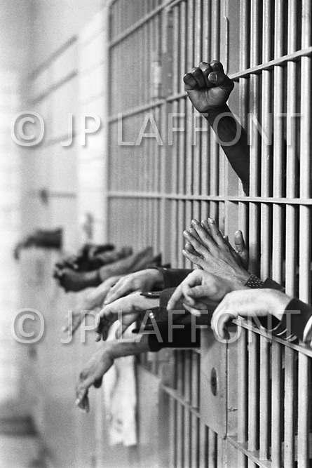 Manhattan, New York City, NY. September 28th, 1972. <br /> Hands from behing the bars at Toms Prison.<br /> Standing on Center Street at Leonard Street, and was built in 1840 with granite from the old Bridewell Prison in City Hall.