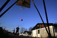 "SERBIA, Belgrade, Jan. 18, 2007..Boys play basketball in a refugee camp ""Krnjaca"" near Belgrade..© Djordje Jovanovic /EST&OST"