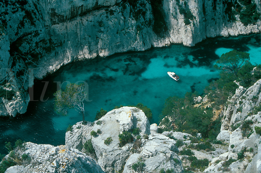 A lone boat in the Calanque d' En Vau, a coastal canyon in the south of France, near Cassis.