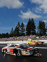 Aug. 7, 2011; Kent, WA, USA; NHRA pro stock driver Mike Edwards (near lane) races alongside Rodger Brogdon during the Northwest Nationals at Pacific Raceways. Mandatory Credit: Mark J. Rebilas-