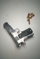 Handgun amd bullets on white seamless<br />
