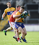 Martin Mc Mahon of Clare in action against Donncha O Connor of Cork during their National Football League game at Cusack Park. Photograph by John Kelly.