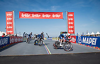 The international UCI Team is the first the roll off the ramp at the race start in Knokke-Heist<br /> <br /> Mixed Relay TTT <br /> Team Time Trial from Knokke-Heist to Bruges (44.5km)<br /> <br /> UCI Road World Championships - Flanders Belgium 2021<br /> <br /> ©kramon