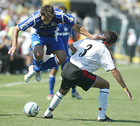 Major League Soccer's Clint Dempsey (left) avoids hitting Fullhams FC's Niclas Jensen (3) during the MLS All Star game in Columbus, Ohio Saturday, July 30, 2005.