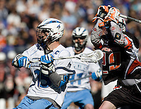 Michael Kimmel (15) of Johns Hopkins looks to shoot as Chris White (29) of Princeton moves in during the Face-Off Classic in at M&T Stadium in Baltimore, MD