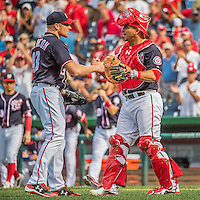 11 September 2016: Washington Nationals pitcher Mark Melancon gets congratulations from catcher Wilson Ramos after Melancon gets the save against the Philadelphia Phillies at Nationals Park in Washington, DC. The Nationals edged out the Phillies 3-2 to take the rubber match of their 3-game series. Mandatory Credit: Ed Wolfstein Photo *** RAW (NEF) Image File Available ***
