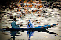Muslim family on a Shikara, or gondola boat, on Dal Lake, Srinagar, Kashmir, India.
