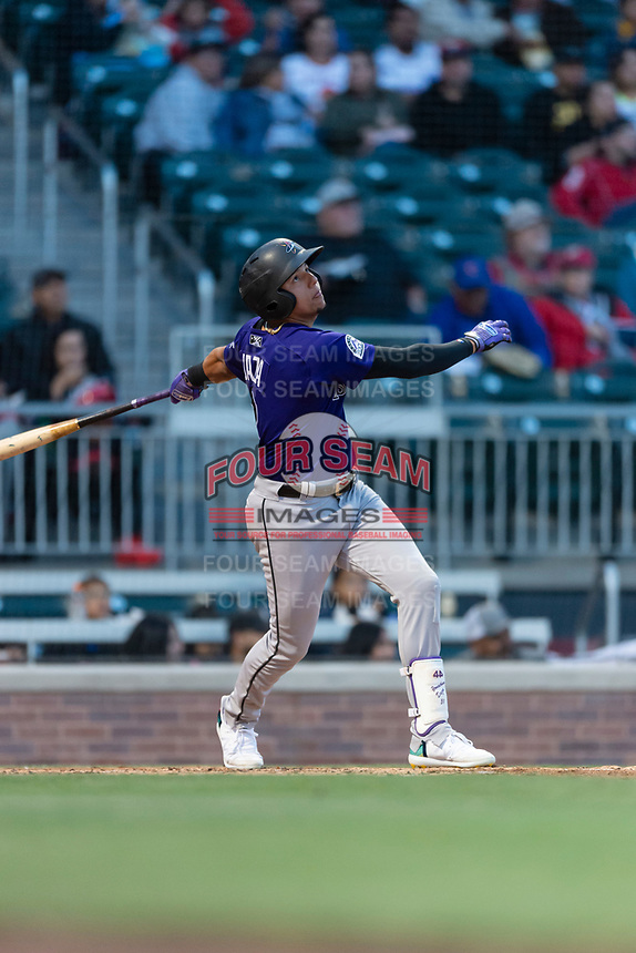 Albuquerque Isotopes center fielder Yonathan Daza (2) during a Pacific Coast League game against the El Paso Chihuahuas at Southwest University Park on May 10, 2019 in El Paso, Texas. Albuquerque defeated El Paso 2-1. (Zachary Lucy/Four Seam Images)