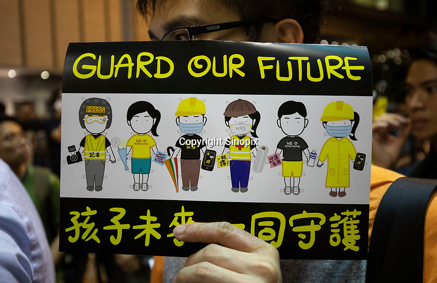 A protester holds a banner as civil servants gather to protest the Hong Kong government's refusal to fully withdraw its controversial extradition bill, Hong Kong, China, 02 August 2019.