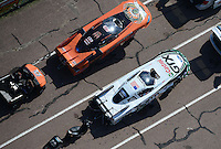 Apr. 28, 2012; Baytown, TX, USA: Aerial view of NHRA funny car driver Mike Neff (bottom) and Todd Lesenko during qualifying for the Spring Nationals at Royal Purple Raceway. Mandatory Credit: Mark J. Rebilas-
