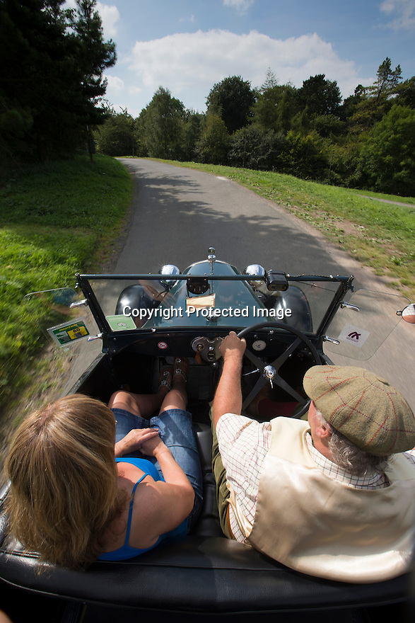 16/08/16<br /> <br /> Debbie Slater enjoys her ride home from the Old Bowling Green pub, Winster.<br /> <br /> You'd be forgiven for thinking you'd had one drink too many if you called a cab in this Derbyshire Peak District village, because you'll get a 1929 vintage Model A Ford turn up as it's the only taxi in town!<br /> <br /> Full story here: https://fstoppressblog.wordpress.com/vintage-car-is-the-only-taxi-in-town/<br /> <br /> What's more, it's the oldest vehicle licensed for private hire in the UK, as cars usually have to be less than three years old to get a licence.<br /> <br /> But thanks to a special exemption to get round not having seat belts and the usual modern specifications, this fabulous-looking car is a regular sight pootling around the narrow lanes of the Derbyshire Dales.<br /> <br /> So when Debbie Slater needed a ride home from the Old Bowling Green pub in Winster she knew exactly who to call for an open-top ride in the sunshine.<br /> <br /> All Rights Reserved, F Stop Press Ltd. +44 (0)1773 550665