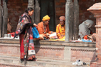 Pashupatinath, Nepal.  Sadhus, Hindu Ascetics or Holy Women, Rest inside a Pati, an Open-Air Resting Place.