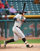 Jon Kemmer (25) of the Fresno Grizzlies follows through on his swing against the Salt Lake Bees during the Pacific Coast League game at Smith's Ballpark on April 17, 2017 in Salt Lake City, Utah. The Bees defeated the Grizzlies 6-2. (Stephen Smith/Four Seam Images)