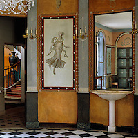 A marble fountain and a Pompeiian dancer painted by Louis Lafitte decorate the walls of the dining room