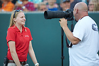 Pulaski Yankees assistant general manager Betsy Haugh talks with her team photographer prior to the game against the Princeton Rays at Calfee Park on July 14, 2018 in Pulaski, Virginia. The Rays defeated the Yankees 13-1.  (Brian Westerholt/Four Seam Images)