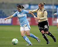 Chicago Red Star forward Karen Carney (14) escapes the pressure by FC Gold Pride forward Tiffeny Milbrett (15).  The defeated the FC Gold Pride defeated the Chicago Red Stars 1-0 at Toyota Park in Bridgeview, IL on May 16, 2009.