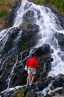 A visitor (MR) at Horesetail Falls along the Richardson Highway, Valdez, Alaska