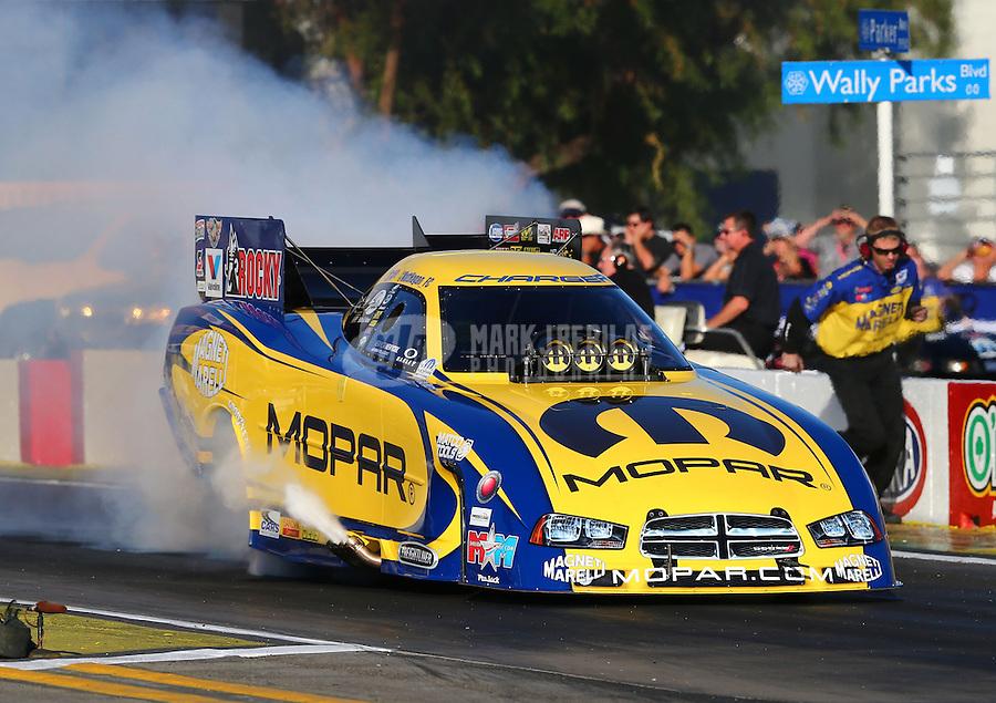 Nov 7, 2013; Pomona, CA, USA; NHRA funny car driver Matt Hagan during qualifying for the Auto Club Finals at Auto Club Raceway at Pomona. Mandatory Credit: Mark J. Rebilas-