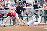 Virginia Cavaliers shortstop Daniel Pinero (22) slides head first ahead of the tag by Arkansas Razorbacks third baseman Bobby Wernes (7) in Game 1 of the NCAA College World Series on June 13, 2015 at TD Ameritrade Park in Omaha, Nebraska. Virginia defeated Arkansas 5-3. (Andrew Woolley/Four Seam Images)