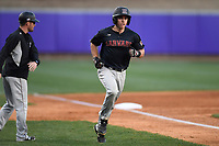 Catcher Devan Peterson (33) of the Harvard Crimson heads to home plate after hitting a home run in game two of a doubleheader against the Furman Paladins on Friday, March 16, 2018, at Latham Baseball Stadium on the Furman University campus in Greenville, South Carolina. Furman won, 7-6. (Tom Priddy/Four Seam Images)
