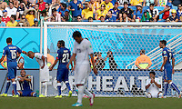 Giorgio Chiellini of Italy (left) holds his shoulder after he claims to be bitten by Luis Suarez of Uruguay (right)