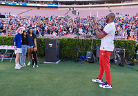 PASADENA, CA - AUGUST 4: Kobe Bryant takes a photo with his family and Megan Rapinoe #15 during a game between Ireland and USWNT at Rose Bowl on August 3, 2019 in Pasadena, California.