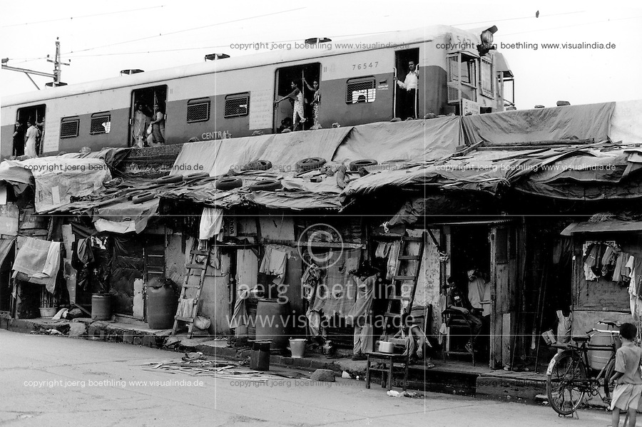 INDIA Maharashtra Mumbai Bombay, city train and slum dweller / INDIEN Mumbai, S-Bahn und Slumbewohner - copyright Joerg Boethling, Also as signed black&white fine print available.