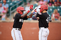 Chattanooga Lookouts second baseman Nick Gordon (1) celebrates with Zandel Wiel (43) as he heads back to the dugout after hitting a home run in the bottom of the first inning during a game against the Jackson Generals on May 9, 2018 at AT&T Field in Chattanooga, Tennessee.  Chattanooga defeated Jackson 4-2.  (Mike Janes/Four Seam Images)