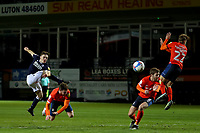 23rd February 2021; Kenilworth Road, Luton, Bedfordshire, England; English Football League Championship Football, Luton Town versus Millwall; Luton Town players attempt to block a shot by Ben Thompson of Millwall but the shot goes wide
