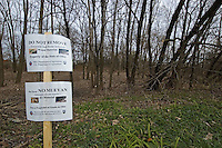 Warning signs mark the boundaries of a forest near Toledo, Ohio, where the ash borer beetle was found in trees. The trees are being destroyed by the ash borer beetle, an invasive species of beetle  thought to have brought into the country from China in wooden pallets used to carry imported goods. The beetle kills the trees by boring under the bark. ..<br />