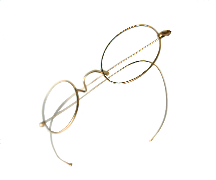 vintage wire-rimmed eyeglasses that have been clipped