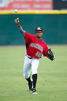 Hickory Crawdads starting pitcher Dillon Tate (38) warms up in the outfield prior to the game against the West Virginia Power at L.P. Frans Stadium on August 15, 2015 in Hickory, North Carolina.  The Power defeated the Crawdads 9-0.  (Brian Westerholt/Four Seam Images)