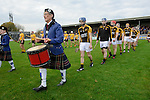 Stan Lineen of Ballyea leads out his side behind the band for their senior county final replay at Cusack Park. Photograph by John Kelly.