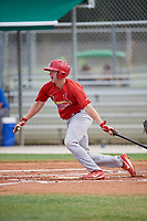 GCL Cardinals catcher Brandon Purcell (4) follows through on a swing during a game against the GCL Mets on August 6, 2018 at Roger Dean Chevrolet Stadium in Jupiter, Florida.  GCL Cardinals defeated GCL Mets 6-3.  (Mike Janes/Four Seam Images)