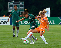 Saint Louis Athletica defender Kendall Fletcher (24) and Sky Blue FC midfielder/forward Kacey White (20) during a WPS match at Anheuser Busch Soccer Park, in St. Louis, MO, July 22 2009. Athletica won the match 1-0.