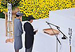 Japan's Emperor Naruhito(R) delivers his remarks with Empress Masako during the memorial service for the war dead of World War II marking the 75th anniversary in Tokyo, Japan on August 15, 2020. (Photo by AFLO)