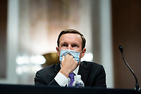 United States Senator Chris Murphy (Democrat of Connecticut), listens during a Senate Health, Education, Labor and Pensions Committee hearing in Washington, D.C., U.S., on Tuesday, June 30, 2020. Top federal health officials are expected to discuss efforts to get back to work and school during the coronavirus pandemic. <br /> Credit: Al Drago/CNP/AdMedia