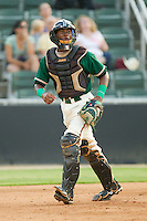 Catcher Carlos Paulino #1 of the Greensboro Grasshoppers on defense against the Kannapolis Intimidators at Fieldcrest Cannon Stadium August 3, 2010, in Kannapolis, North Carolina.  Photo by Brian Westerholt / Four Seam Images