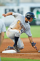 Danny Oh (8) of the Charleston RiverDogs slides into third base during the South Atlantic League game against the Greensboro Grasshoppers at NewBridge Bank Park on July 17, 2013 in Greensboro, North Carolina.  The Grasshoppers defeated the RiverDogs 4-3.  (Brian Westerholt/Four Seam Images)