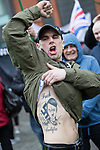 """© Joel Goodman - 07973 332324 . 28/03/2015 . Manchester , UK . A man with a large Adolf Hitler tattoo on his torso . Approximately 100 neo-Nazis gather in Manchester for """" White Pride Worldwide day """" . Photo credit : Joel Goodman"""